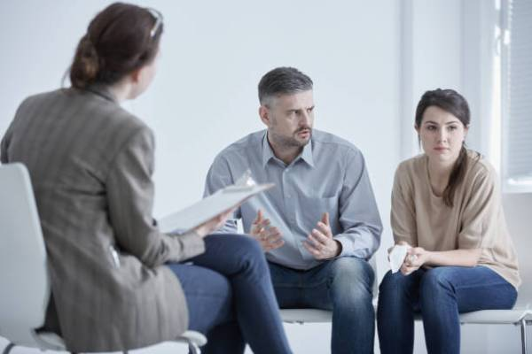 Family therapist during meeting with unhappy, married couple